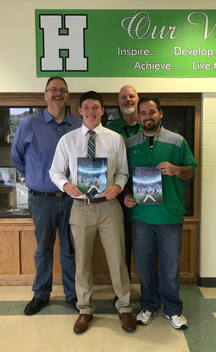 Pictured: Elijah McCloskey, Athletic Director Justin Kellough, Publisher Chris Scott and HS Principal Craig Kerns.