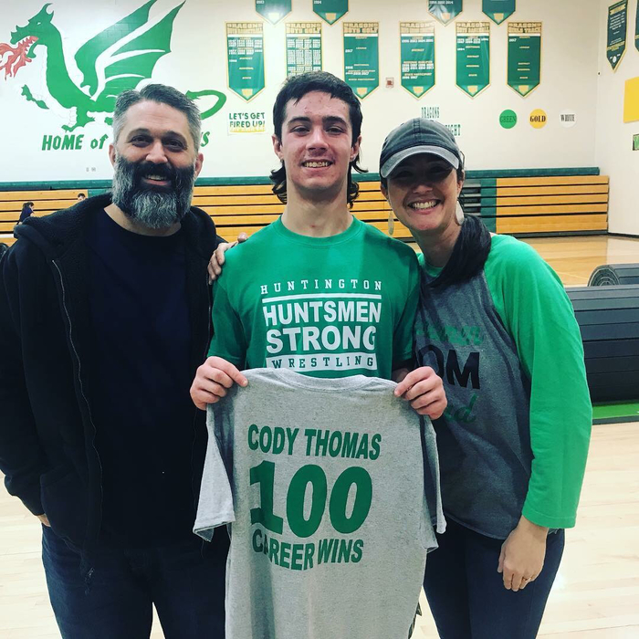 Cody Thomas with his parents