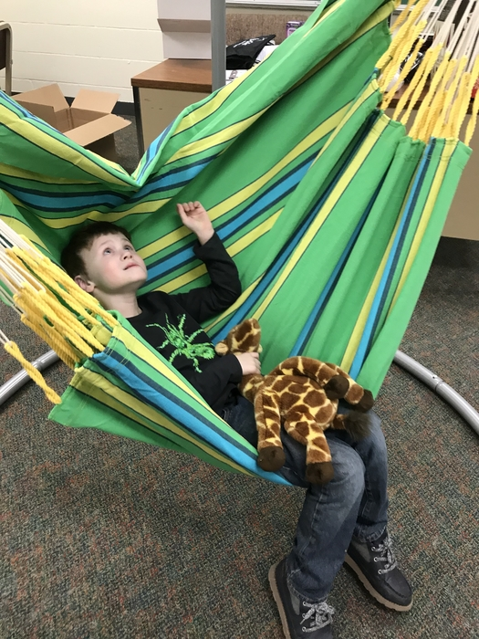 Proud Huntsmen taking a sensory break in our new swing.