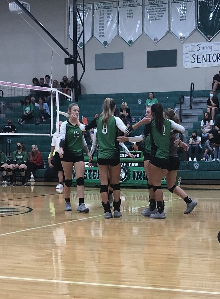 Lady Huntsmen celebrate a point in their game at Western tonight.